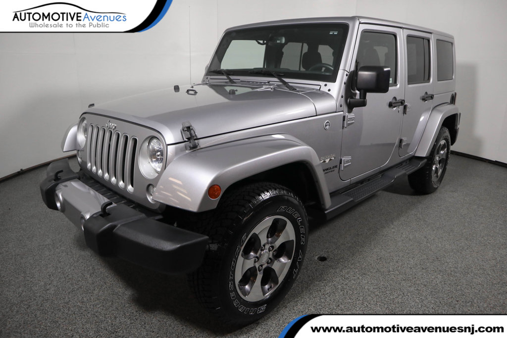 Pre-Owned 2016 Jeep Wrangler Unlimited 4WD 4dr Sahara 6 Speed Manual with Navigation