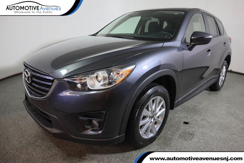 Pre-Owned 2016 Mazda CX-5 2016.5 FWD 4dr Touring w/ Bose/Moonroof Package