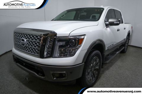 Pre-Owned 2018 Nissan Titan 4x4 Crew Cab Platinum Reserve with Utility Package